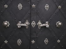 Decorative doors. Details of closed doors with decorative handles and metal ornaments Stock Photo