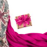 Decorative draping frame of the textile. Women`s scarf red figur. E the British flag. White background top view. Gift box with surprise Royalty Free Stock Photography