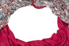 Decorative draping frame of the textile. Women`s scarf red figure the British flag. White background top view Royalty Free Stock Image