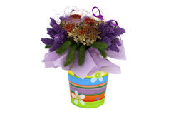 A decorative dried flower bouquet in a pot. A decorative dried flower bouquet isolated on white stock images