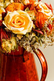 Decorative dry flowers background. Beautiful dry flowers arranged in red vase, decorative background Royalty Free Stock Images