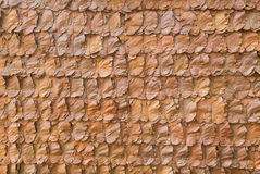 Decorative dry leaves on traditional wall Royalty Free Stock Photos
