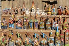 Decorative earthenware wine jugs are sold in the tourist market in historical town Mtskheta near Tbilisi, Georgia stock images