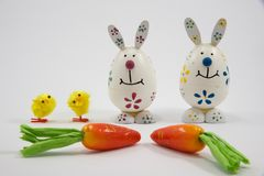 Decorative Easter bunnies, chicks and carrots stock photo