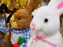 Decorative Easter bunnies white and brown. Decorative Easter bunnies white with the pink bottom  and brown with shovel and carrot stock images