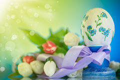 Decorative easter egg with a bouquet of spring tulips Royalty Free Stock Photo