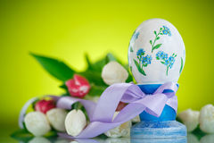 Decorative easter egg with a bouquet of spring tulips Stock Photo