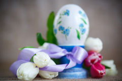 Decorative easter egg with a bouquet of spring tulips Stock Image
