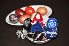 Decorative easter egg and doll on black background Royalty Free Stock Images