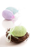 Decorative Easter egg in a nest Stock Images