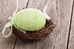 Decorative Easter egg in a nest Stock Photos