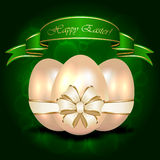 Decorative Easter egg with ribbon on green backgro Stock Photography