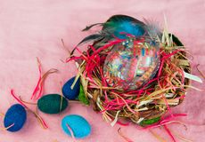 Decorative Easter egg and woolen eggs in the basket Stock Image