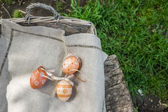 Decorative easter eggs in basket on the grass Stock Photography
