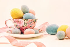 Decorative easter eggs in china cup Stock Photo