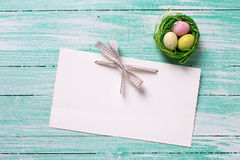 Decorative Easter eggs and empty tag Royalty Free Stock Image