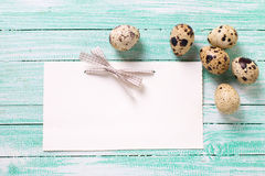 Decorative Easter eggs and empty tag on wooden background. Stock Images