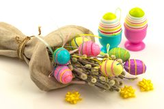 Decorative easter eggs in flax sack Stock Photos