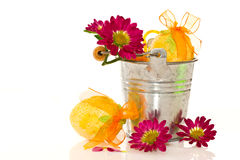 Decorative easter eggs in a bucket of flowers Stock Images