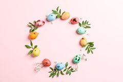 Decorative Easter eggs and flowers on white background, space for text stock photography