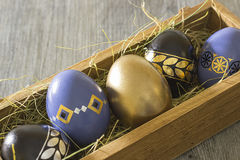 A decorative easter eggs on a gray wooden background Royalty Free Stock Photography