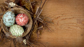 Decorative easter eggs made of paper in nest Royalty Free Stock Photos