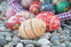 Decorative easter eggs in outdoor in the gravel Royalty Free Stock Photos