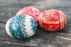 Decorative easter eggs in outdoor on wooden table Royalty Free Stock Image