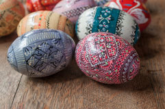 Decorative easter eggs in outdoor on wooden table Stock Photos