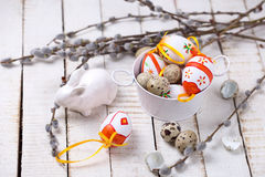 Decorative easter eggs , rabbit and  willow  branches on wooden. Background. Easter background. Selective focus. Place for text Stock Photos