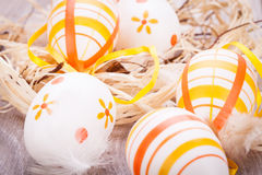 Decorative Easter eggs, on a rustic wooden table Royalty Free Stock Photo