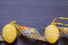 Decorative Easter eggs, on a rustic wooden table Stock Photos