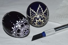 The decorative Easter eggs. Two blue decorative carved easter eggs , traditional handicraft Royalty Free Stock Photography