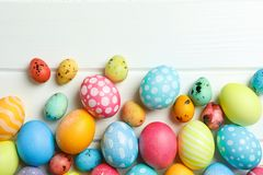 Decorative Easter eggs on white wooden background, space for text royalty free stock photos