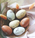 Decorative Easter Eggs in wooden Basket with linen cloth Stock Image