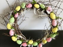 Decorative Easter Wreath with Pink ,Green and Yellow Eggs stock photography