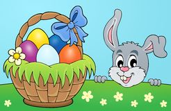 Decorative egg basket and lurking bunny Royalty Free Stock Image