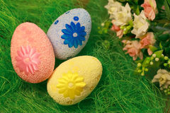 Decorative eggs on green grass. Chicken basket. Concepts Easter, eggs, hand made Stock Photo