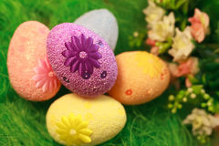 Decorative eggs on green grass. Chicken basket. Concepts Easter, eggs, hand made Stock Images