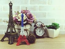 Decorative eiffel tower and different home decor related objects Stock Photos