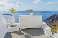 Decorative elements adorn  traditional Greek house. Therasia on backdrop. Santorini ( Thira ) island Stock Photography