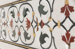 Decorative elements created by applying paint, stucco, stone inlays and carvings Stock Photos