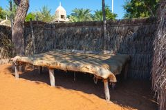 Decorative elements of urban improvement in the resort town - bed made of natural materials under a canopy, Heritage Village, Abu. Dhabi royalty free stock image