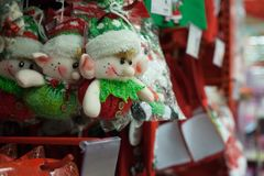 Decorative elves to buy from a shop. Christmas decorative elves hanging on a shelf in a shop Royalty Free Stock Photo