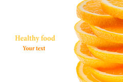 Decorative ending from a pile of slices of juicy orange on a white background. Fruit border, frame. Isolated. Food background. Cop Royalty Free Stock Photos