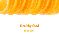 Decorative ending from a pile of slices of juicy orange on a white background. Fruit border, frame. Isolated. Food background. Cop Royalty Free Stock Photography