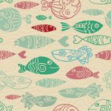 Decorative endless underwater marine background. Vector seamless pattern with hand drawn funny fishes in sketch style. Fabric desi. Gn. Eps-8 Royalty Free Stock Image