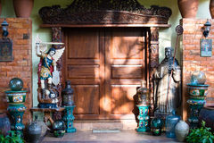 Decorative entrance with wooden door to the hotel in Philippines Stock Photo