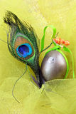 Decorative egg and peacock feather Royalty Free Stock Image
