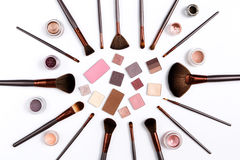 Decorative eyeshadow and makeup brushes flat lay Stock Photography